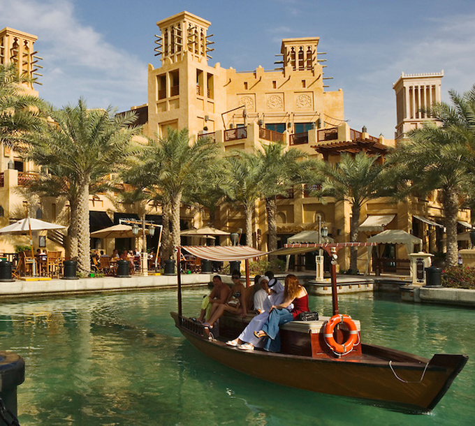 Visitors take water taxi/abra from the souk at Madinat Jumeirah. Dubai. United Arab Emirates.